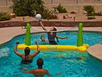 Playing swimming pool volley ball