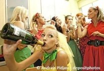 Beautiful girls drinking alcohol at a party