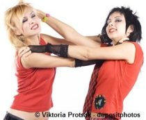 Two girls fighting and pulling each other's hair