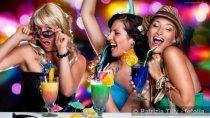 Three girls cheering and having fun at a party