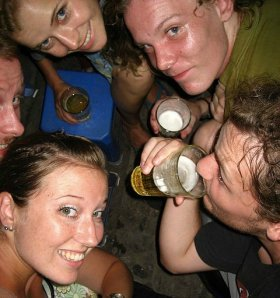 A Teenage Group of College friends drinking beer