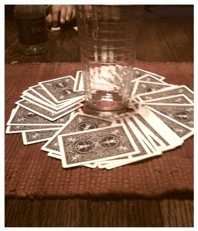 a deck of playing cards with a glass in the center