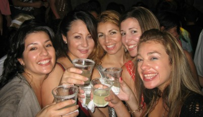 A group of girls having alcohol drinks at a party