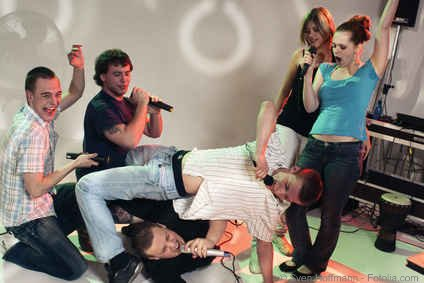 Crazy party group doing karaoke twister moves