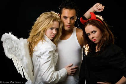 Two hot girls one blonde angel and one brunette devil with man - choosing between Truth or Dare