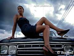 girl sitting on a car bonnet