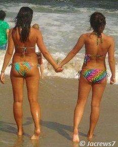 Beautiful Bikini Girls holding each other's hands