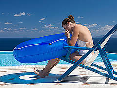 Adult Pool Party Games A girl blowing into a pool tube