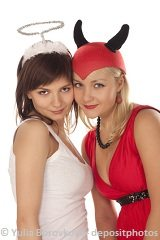beatuiful girls in angel and devil costume posing together