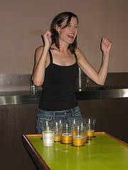Happy girl playing beer pong