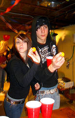 Couple playing Beer Pong