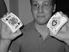 A man showing a King and An Ace Card