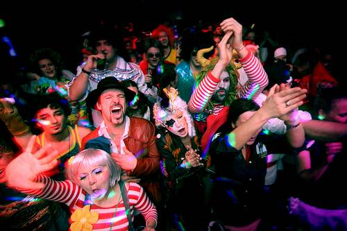 Large group of people having fun at a Carnival party