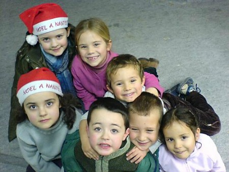 A group of small kids at a christian children party