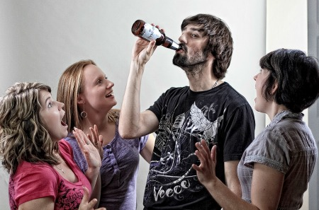 Guy dared to drink the whole bottle in one go while girls watching him with excitement