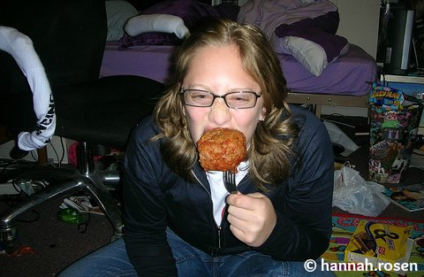 Girl.. eating a huge meatball