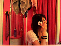 Girl prank calling with her mobile phone