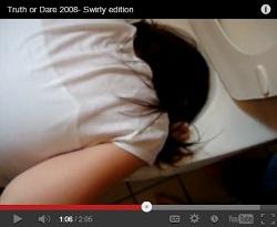 Girl putting her head in toilet dare video