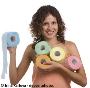Girl in towels holding many tissue paper rolls