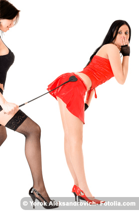 Woman spanking another woman