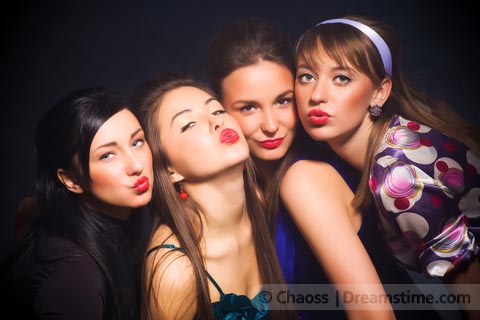 Girls posing with pursed lips