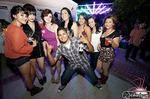 A group of beautiful ladies and a guy partying  and having fun