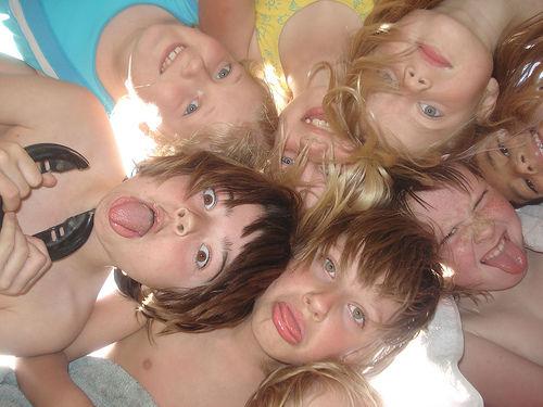 A group of kids mocking together