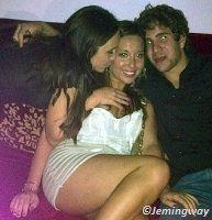 Girl kissing another girl