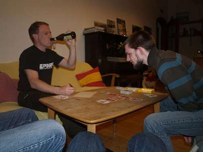 Friends Drinking and Playing Card Games