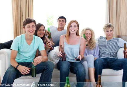 A group of friends sitting and drinking together