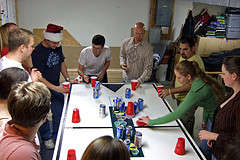A Large Group of Friends Playing Flip Cup