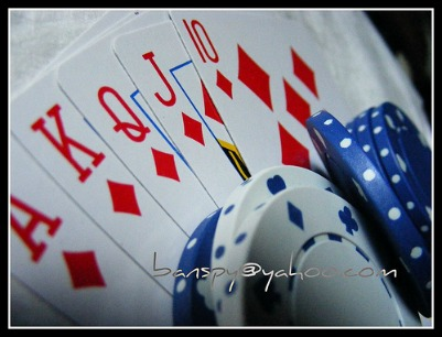 Some Playing Cards along with Chips
