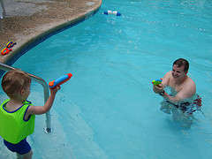 Wild Pool party games Playing with water guns in pool