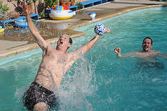 Swimming Pool Games Blowing up a toypedo ball
