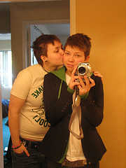 Twin Sisters Kissing Taking a photo while kissing