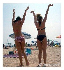Girls fooling around at a beach