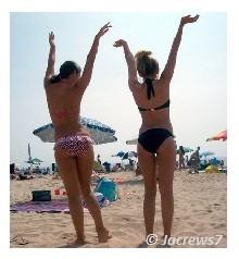 Girls fooling around at a beach