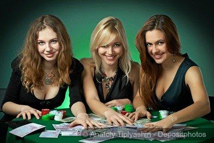 Three beautiful girls playing poker