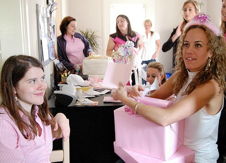 Girl collecting gifts at her bridal shower party
