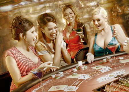 Beutiful girls playing some drinking card games at a casino