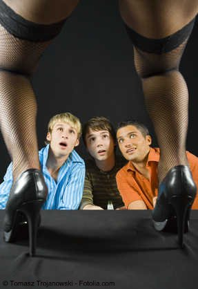 three young guys looking up to strippers leg stocking
