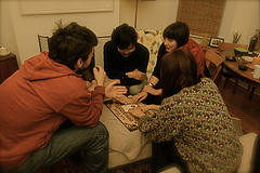 A group of friends playing Ouija