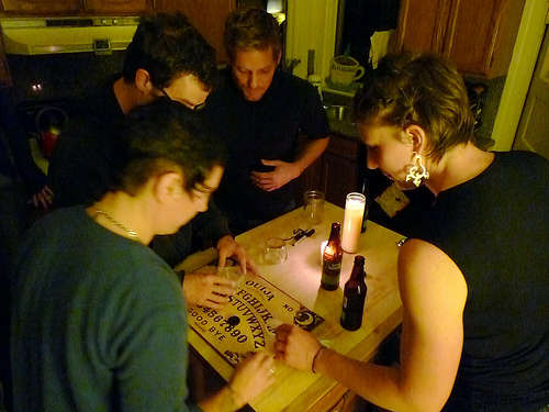 friends playing scary Ouija game