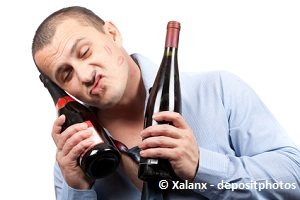 drunken man with wine bottles making funny face