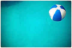Swimming Pool games A beachball in the water